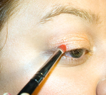 Applying crease color with a crease brush